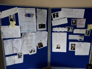 a noticeboard containing children's work on famous scientists